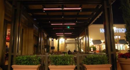 A restaurant patio with inadequate lighting at Fashion Island